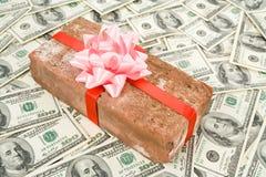 Presente e dólares da partida Foto de Stock