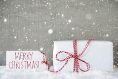 Presente, fundo com flocos de neve, Feliz Natal do cimento do texto Fotografia de Stock