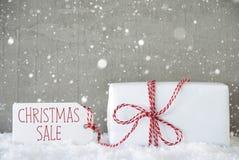 Presente, fundo com flocos de neve, venda do cimento do Natal do texto Imagens de Stock