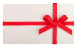 Presente ou letra em branco com uma curva vermelha Fotografia de Stock Royalty Free