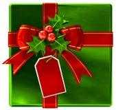 Presente verde do Natal com fita e curva vermelhas Foto de Stock Royalty Free