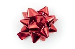 Presente vermelho da curva Fotografia de Stock Royalty Free