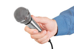 Presenter holding a microphone in hand. Isolated on white background royalty free stock image