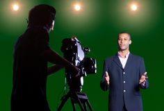 Presenter piece to camera in TV Studio Stock Images