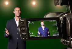 Presenter in the Viewfinder of a Digital Video Camera royalty free stock photography