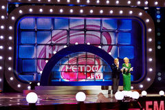 Presenters of festival D.Kharatyan and T.Vedeneeva. MOSCOW - DEC 17: Presenters of festival Dmitry Kharatyan and Tatyana Vedeneeva on stage in concert Legends of Royalty Free Stock Photos