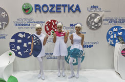 Presenters work on Rozetka company booth at CEE 2015, the largest electronics trade show in Ukraine. Girls presenters work on Rozetka, Ukrainian online Royalty Free Stock Image