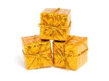 Presentes brillantes de oro Imagen de archivo libre de regalías