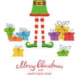 Presentes de Natal e pés do duende Imagens de Stock Royalty Free