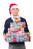 Presentes de sorriso do Natal da terra arrendada do homem Fotografia de Stock Royalty Free