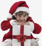 Presentes de una niña y de Navidad Fotos de archivo