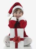 Presentes de una niña y de Navidad Imagen de archivo libre de regalías