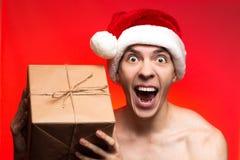 Presentes del día de fiesta de la Navidad Regalo loco del Año Nuevo del control del hombre Stylis Imagenes de archivo
