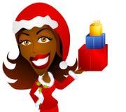 Presentes do Natal da terra arrendada da mulher do americano africano Fotos de Stock