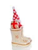 Presentes do Natal nas botas das crianças imagens de stock royalty free