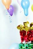 Presentes e balões Fotografia de Stock Royalty Free