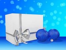 Presentes e quinquilharias do Natal contra Bokeh Imagens de Stock Royalty Free
