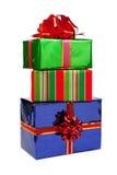 Presentes em pacotes coloridos com curvas. Imagens de Stock Royalty Free