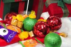 Presentes, sinos e doces do Natal Foto de Stock Royalty Free