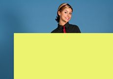 Presenting. Business woman with a yellow shield royalty free stock photos