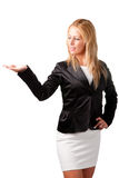 Presenting. Young woman standing with her hand outstretched, as though she is presenting a product Stock Photo