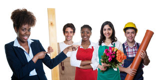 Presenting african american businesswoman with group of other apprentices Stock Photography