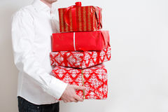Presenting alot of gifts Stock Photography