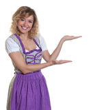 Presenting bavarian woman with curly hair Stock Photo