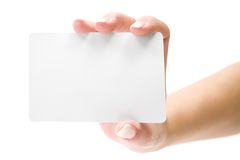 Presenting a Blank Card. Businesswoman holding a blank card. Isolated on a white background royalty free stock photography