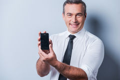 Presenting brand new smartphone. Royalty Free Stock Photo