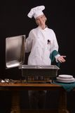 Presenting buffet. Assertive posed female presenting buffet Royalty Free Stock Photo