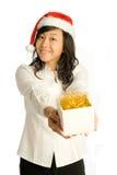 Presenting Christmas Gift Royalty Free Stock Photos