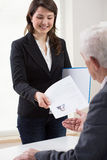 Presenting curriculum vitae Stock Photos