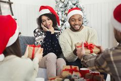 Presenting gifts as Christmas eve tradition stock images