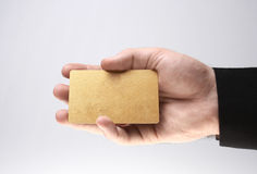 Presenting a golden card Stock Photo