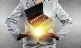 Presenting laptop Royalty Free Stock Photo