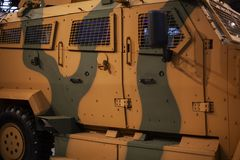 Camouflage military transport vehicle green-yellow color royalty free stock photo