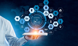 Presenting media technologies . Mixed media. Close of businessman holding digital tablet computer presenting social network. 3D rendering Royalty Free Stock Photography