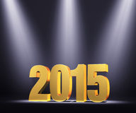 Presenting New Year 2015. Gold 2015 on dark stage, brightly illuminated by three slightly blue spotlights Stock Photos