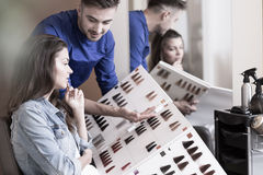 Presenting a pallet. Hairdresser is presenting a pallet of colors Royalty Free Stock Image