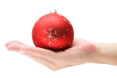 Presenting a Red Christmas Bauble Royalty Free Stock Image
