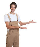 Presenting young carpenter Stock Photo