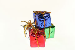 Presents. Four presents tied with silver ribbon Stock Images
