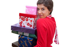 Presents. A girl holds a lot of gifts Royalty Free Stock Photo