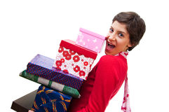 Presents. Happy girl holds a lot of gifts Stock Image