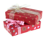 Presents. Two gift boxes which have been tied up by tapes with bows, isolated on a white background Royalty Free Stock Image