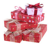 Presents. Five gift boxes which have been tied up by tapes with bows, isolated on a white background Royalty Free Stock Images
