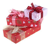 Presents. Three gift boxes which have been tied up by tapes with bows, isolated on a white background Stock Images