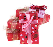 Presents. Five gift boxes which have been tied up by tapes with bows, isolated on a white background Stock Photo