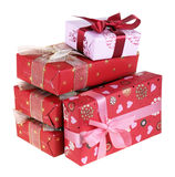 Presents. Five gift boxes which have been tied up by tapes with bows, isolated on a white background Royalty Free Stock Photos